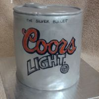 Can Of Coors Chocolate cake with chocolate BC filling and frosted with choc. BC. Covered in fondant and painted with lustre dust. Label is hand painted...