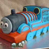 Thomas The Tank White cake covered in BC and fondant. First time with the fondant rope gun...amazing!! I love it! I was nervous about Thomas, but all in...