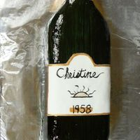 Wine Bottle Birthday I made this for my friend's mom's birthday. It is a chocolate cake w/raspberry BC, covered in fondant. I got the shine effect by...