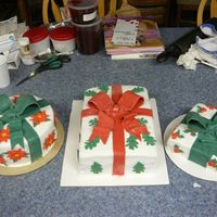 "Christmas Present Cakes Just finished these for a large event. Covered in plain rolled fondant. Bows are made from fondant as well. The ""gift-wrap""..."