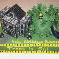 Batman Cake - Wayne Manor And Batcave This is a cake that I did for a close friend's child. It is Wayne Manor sitting next to a hill with the Batmobile coming out of the...