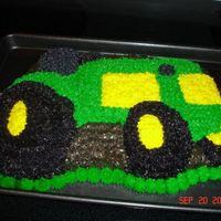 3Rd Cake John Deere tractor ... Had a problems with some of the icing melting... Still trying to get it right.