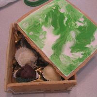 Cookie Box   Edible cookie boxes with flooded RI on the lid, filled with assorted truffles