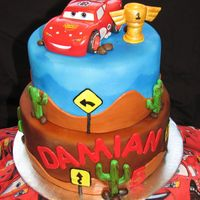 Cars My son's 5th birthday cake. Cake is chocolate, filled with cherries, covered in buttercream, then fondant!