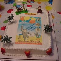 Curious George Cake for my daughter's 3rd birthday. Chocolate cake with whipcream filling and frosting. I made the edible image and got a deco pac of...