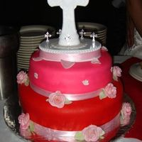 Confirmation Cake I had made for my neice's confirmation . Top cake is a red velvet cake with cream cheese frosting and filling and covered in pink...