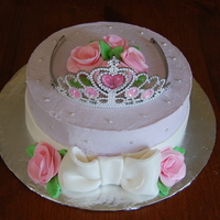 Princess Whipped cream icing with fondant roses and bow. Tiara is plastic.