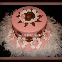 Pink And Brown Baby Shower 8-inch cake covered in pink and brown fondant with fondant decorations. Thanks for looking!