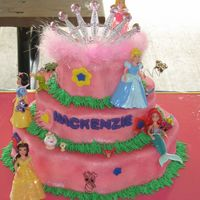 Princess WASC covered in fondant w/ fondant accents. The disney princess i bought from the toy store.......