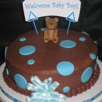 Baby Boy Bear white chocolate sour cream cake w/ chocolate buttercream icing and cookies and cream filling. Fondant polkadots and bear......