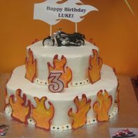 Motorcycle Cake White chocolate colored flames. WASC w/ BC icing.