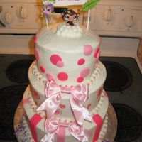 Pink W/ Monkeys WASC w/ buttercream icing and fondant accents. The monkey on the top was from littlest pet shop.
