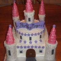 "Img_1056.jpg castle cake. towers made of mmf and covered in mmf. 2 tier 12"" square bottom and 10'"" round top."