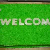 Welcome Mat Housewarming Cake   buttercream with fondant accents/words