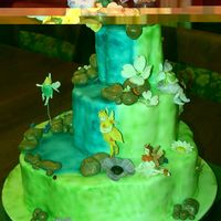 Fairy Cascade This is a fondant covered cake with an airbrushed waterfall and gumpaste fairies and flowers