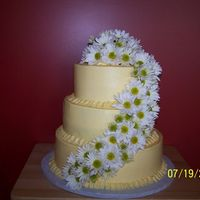 Vanessa Rd Three Tier 8, 10 & 12 white cake, bc icing, fresh daisies