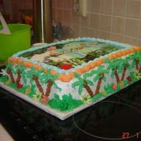 Madagascar Edible picture, buttercream palms with coconuts, fondant flowers