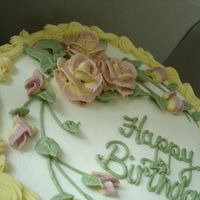 Two-Tone Rose Birthday Cake Buttercream with yellow/pink roses.