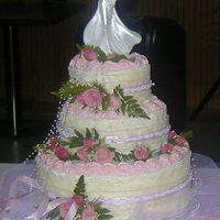 My First Wedding Cake   12, 8, and 6 inch layers. BC icing......decorated with fresh flowers to match the bride's.