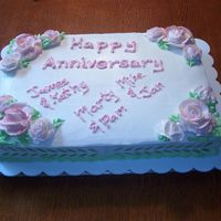 Anniversary Sheet Cake  Some firsts for me......BC roses, my third attempt at making them, first time using them on a cake....And got to use my airbrush for the...