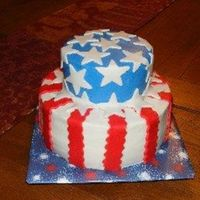 4Th Of July Top layer yellow and bottom is chocolate frosted in BC with Fondant Accents. Hubby requested a flag cake, and this is what I decided on. He...