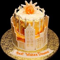 Atlanta Skyline Cake Yellow cake with mango coconut filling, bc frosting with white choc buildings and accents