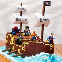 Pirate Ship Birthday  The 4 year old birthday boy wanted a 'Super Hero Pirate Ship', so this is what I came up with. Chocolate cake, fondant deck and...