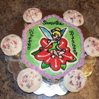 "Tinkerbell Flower Cake Tinkerbell buttercream transfer done on Wilton Daisy Cake Mold...Chocolate.Cupcakes sprinkled with ""fairy dust"""