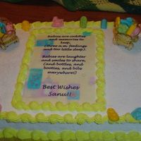 Baby Shower Cake Very Simple and very appropriate for an unknown sex?? baby shower. All misc items around cake are made of chocolate.