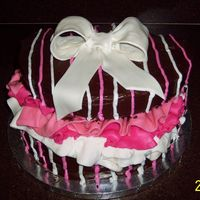 Hat Box Cake Chocolate cake with Chocolate icing, buttercream accents and gumpaste bow and tissue paper