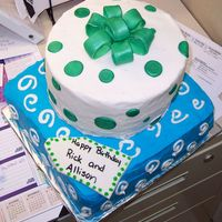 Stacked Presents 10 inch square cake on bottom, 8 inch round on top with buttercream and gumpaste bow.