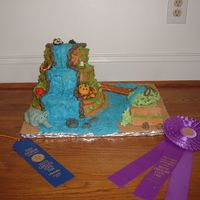 State Fair Rainforest Cake Here is a cake i did for the state fair. The animals are all made out of fondant.
