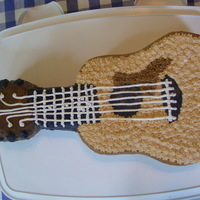 Guitar Cake My brother got a guitar for his birthday and this is made to look like the guitar.