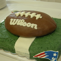 "New England Patriots Football To get the ""pigskin"" texture I used a brand new football and rolled it on the already covered football cake. Used color flow for..."