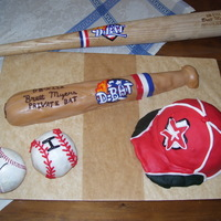 Astros Baseball, Bat, And Ball This was for my little brothers 8th birthday. All is edible and made out of fondant. The bat was given to my brother from Houston Astros...