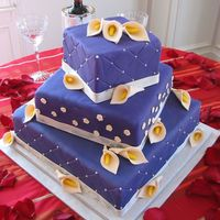Purple Square Wedding Cake this one terrified me, but it turned out great. Bride wanted flowers on the middle section for whimsy and boy, I think I might fall in love...