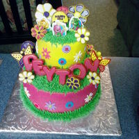 Peyton  borrowed cake idea from someone on cakecentral i believe. flowers and name are cookies. fondant accents. stacked 10 inch bottom, stacked 6...