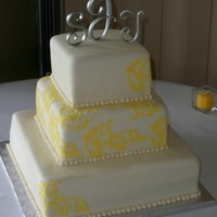 Yellow Design 3 tiered 6, 8, 12 squares. Yellow patteren is scanned directly from the brides invitation and cut out by my cricut cake using the make the...
