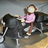 Monkey Riding A Harley This was a crazy cake to make. It is built on a wooden support, cake carved covered in fondant and airbrushed black. The monkey is choc...