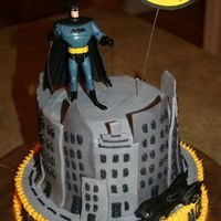 Batman This was for my nephew's 5th bday. I ran out of fondant, which is why there are no building around the back of the cake. I'm sure...