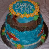 Luau Bridal Shower This is a cake I made for a co-worker for a Hawaiian themed shower. It's frosted with buttercream; the flowers and fish were made of...