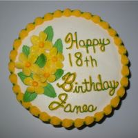 18Th Birthday Cake Flower  This was for an 18th Birthday party. It was a double layer 8 inch yellow cake iced in buttercream with MMF flowers. They requested yellow...