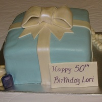 Tiffany Box This was my attempt at a Tiffany box for my friend's mother's 50th birthday. This cake was harder to make than I expected. Who...