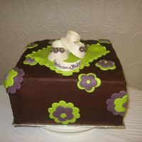 "Plum And Lime Green Baby Shower Cake  Baby's room was being decorated in these colours so cake was made to match. Gumpaste shoes and MMF decorations on a 10"" square..."