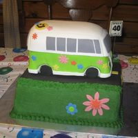 Vw Bus Cake for a 40th birthday party with a 1969 theme. Chocolate stout cake with ganache, covered in fondant with fondant decorations. The base...