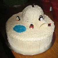 Igloo And Penguins I had lots and lots of help with this cake by my two kids. They made the fondant penguins, helped make and frost the cake and of course art...