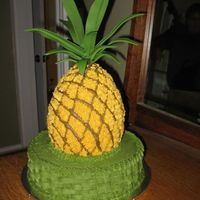 Pineapple_3.jpg My aunt loves pineapples. I made her this cake for her birthday. It's WASC frosted with buttercream and topped with gumpaste leaves....