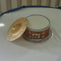 Drum Fondant with gumpaste cymbal. Forgot my camera so had to use my cell.