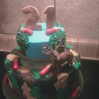 Hunting Buttercream with fondant shot gun shells, and toy deer.