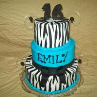 Zebra And Blue Buttercream with fondant stripes and fondant bow.